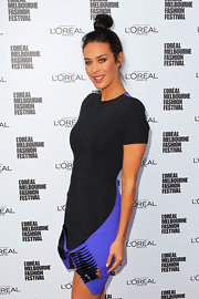 Megan Gale sported a space-age vibe in a blue and black cocktail dress with a slashed hem at the L'Oreal Melbourne Fashion Festival.