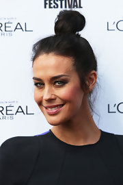 Megan Gale pulled her hair up in a top knot for the L'Oreal Melbourne Fashion Festival.