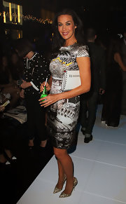 Megan Gale attended the L'Oreal Melbourne Fashion Festival carrying a chic studded white clutch.