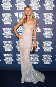 Toni Garrn was a head turner in a slinky floral halter gown by Ulyana Sergeenko at the L'Oreal Paris Blue Obsession party.