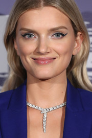Lily Donaldson glammed up her look with a diamond statement necklace by Bulgari.