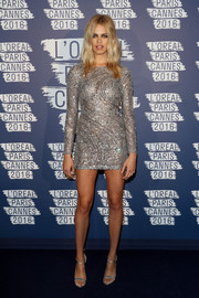 Hailey Clauson kept the shimmer coming with a pair of strappy silver heels.