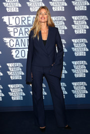 Doutzen Kroes rocked a baggy navy pantsuit by Calvin Klein at the L'Oreal Paris Blue Obsession party.