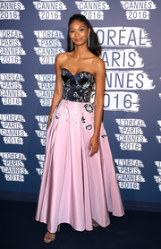 Chanel Iman veered from her usual skin-revealing style and donned this sweet two-tone strapless gown by Ralph & Russo for the L'Oreal Paris Blue Obsession party.