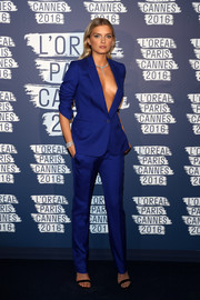 Lily Donaldson turned up the heat in a cobalt Stella McCartney pantsuit worn sans shirt at the L'Oreal Paris Blue Obsession party.