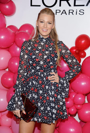 Blake Lively paired a red sequin purse by Chanel with a heart-print mini dress for the L'Oreal Paris Paints + Colorista launch.