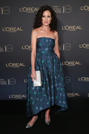 Andie MacDowell added extra shine with a metallic silver clutch.