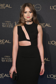 Kristina Bazan attended the L'Oreal Paris Women of Worth celebration sporting a crystal-studded clutch and cutout dress combo.