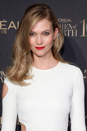 For her lips, Karlie Kloss chose an eye-popping red hue.