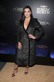 Eva Longoria flashed some cleavage in a deep-V charcoal wrap dress at the L'Oreal Women of Worth celebration.