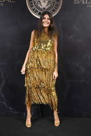Giovanna Battaglia matched her fabulous dress with a pair of gold ankle-tie sandals.