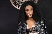 Winnie Harlow attended the L'Oreal x Balmain party wearing her hair in tight curls.