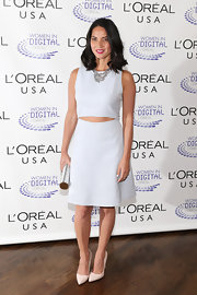 Olivia showed just a touch of skin with this crisp white dress with a revealing cutout.