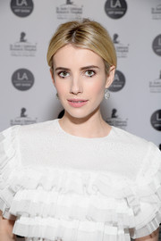 Emma Roberts pulled her hair back into a loose updo for the LA Art Show 2017.