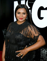 Mindy Kaling sealed off her look with a solid cream mani.