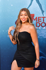 Jordyn Woods accessorized with a stylish gold watch at the premiere of '47 Meters Down Uncaged.'