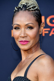 Jada Pinkett Smith brightened up her beauty look with a swipe of hot-pink lipstick for the LA premiere of 'Angel Has Fallen.'