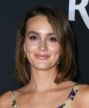 Leighton Meester prettied up her eyes with amethyst shadow.