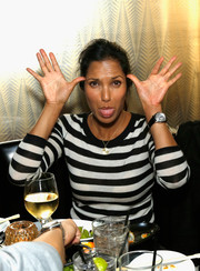 Padma Lakshmi teamed a black leather-band chronograph watch with a striped shirt for the Charades Benefit Gala.