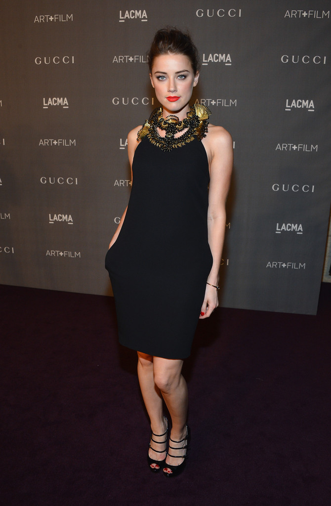 Actress Amber Heard arrives at LACMA 2012 Art + Film Gala Honoring Ed Ruscha and Stanley Kubrick presented by Gucci at LACMA on October 27, 2012 in Los Angeles, California.