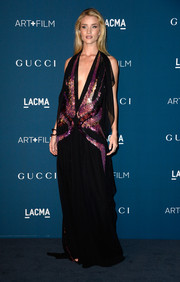 Rosie Huntington-Whiteley unleashed her inner goddess at the LACMA Art + Film Gala in an embellished black and pink Gucci gown featuring a deep-V neckline.