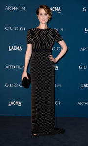 Evan Rachel Wood went for subtle elegance in a studded black Gucci gown during the LACMA Art + Film Gala.