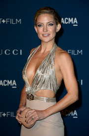 Kate Hudson opted for a simple nude hard-case clutch to complete her LACMA Art + Film Gala look.