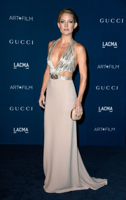 Kate Hudson looked to-die-for at the LACMA Art + Film Gala in a nude Gucci gown with an embellished bodice, waist cutouts, and ultra-sexy neckline.