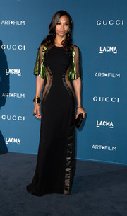 Zoe Saldana cut a curvy silhouette in an ultra-elegant black and green mesh-panel evening dress by Gucci at the LACMA Art + Film Gala.