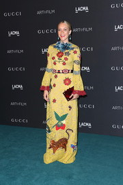 Chloe Sevigny went for quirky glamour at the LACMA Art + Film Gala in a yellow lace gown by Gucci adorned with a smattering of whimsical embroidery.
