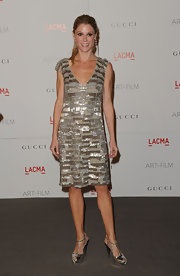 Julie Bowen dazzled at the LACMA soiree in a beaded cocktail dress. She paired the look with complementing metallic T-strap platform sandals.