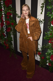 Kate Bosworth made a bold statement with this oversized tan corduroy pantsuit at the Land of Distraction launch.