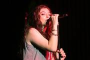 Lorde accessorized with layers of gold bracelets at the LAVA Lucky 13 party.