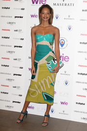 Malaika Firth teamed her cute dress with teal suede ankle-strap sandals.