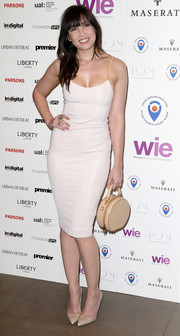 Daisy Lowe's round purse added a vintage feel to her look.