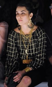 Noomi Rapace loaded up on the bling when she attended the Mark Fast fashion show. She wore a pair of dangling gold hoops and layers of necklaces.