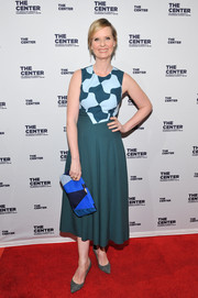 Cynthia Nixon added more graphic appeal with an L.K.Bennett suede clutch in various shades of blue.