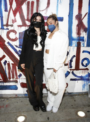 Dixie D'Amelio kept it low-key in a black pantsuit at the celebration of Lil Huddy's new single 'America's Sweetheart.'
