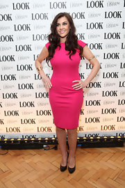 Imogen Thomas paired her bright pink dress with classic pumps.