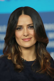 Salma Hayek attended a press conference for 'La Chispa de la Vida' wearing her center-parted tresses in sleek curled layers.