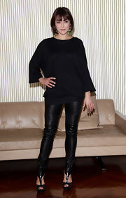 Valentina wears leather leggings with her all black ensemble in Milan.