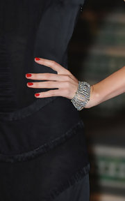 Miranda Kerr paired her elegant gown with a sparkling diamond bracelet.
