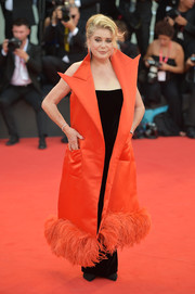 Catherine Deneuve looked fabulous in a sleeveless, feather-hem coat by Jean Paul Gaultier Couture at the 2019 Venice Film Festival opening ceremony.