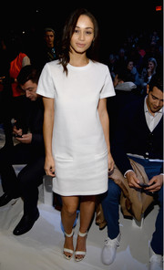 Cara Santana kept it low-key in a short-sleeve white dress during the Lacoste fashion show.