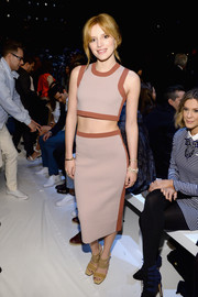 Bella Thorne's taupe Lacoste pencil skirt and matching crop-top did a great job of showing off her super-slim physique.