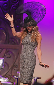 Sarah Jessica Parker wore an extravagant decorative hat with a whimsically mysterious design to the Ladies Luncheon at Crown Palladium.