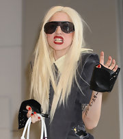 Lady Gaga rocked leather fingerless gloves while arriving in Japan.