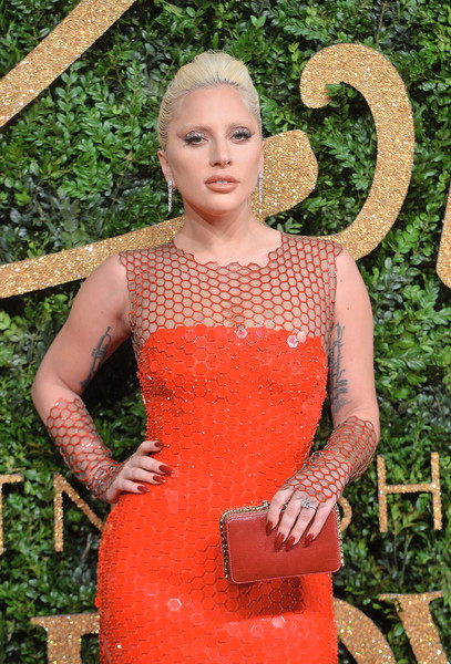 Lady Gaga Leather Clutch [clothing,dress,orange,blond,cocktail dress,photo shoot,fawn,lady gaga,british fashion awards,london coliseum,england,red carpet arrivals]