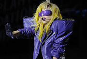 Gaga completed her outrageous stage ensemble with a pair of metallic purple shades.