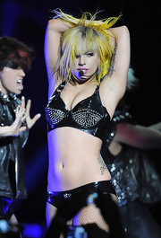 Lady Gaga hit the stage sporting a studded latex bra with matching underpants and fishnets.